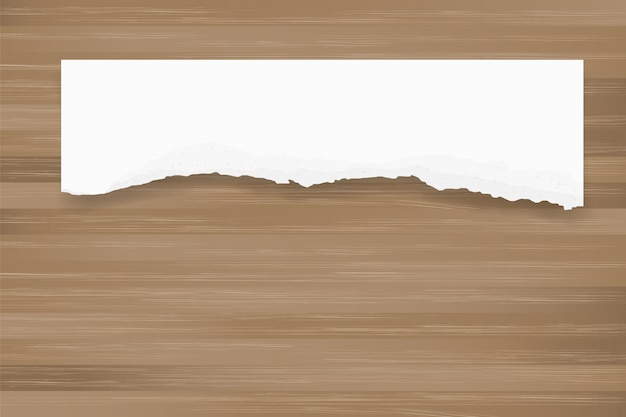 Ripped paper background on brown wood texture.
