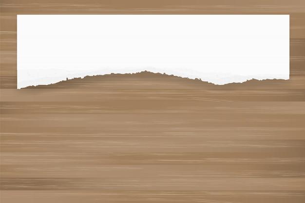茶色の木の質感に紙の背景を裂いた。紙切れが発生しました。