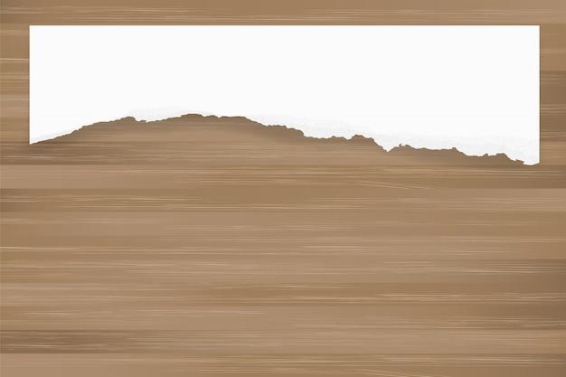 茶色の木の質感に紙の背景を裂いた。