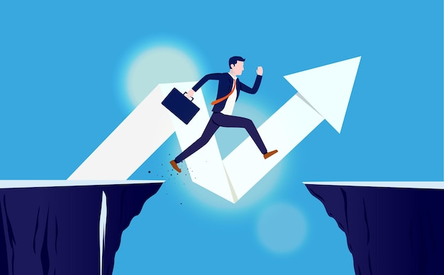 Risk and reward. businessman jumping over gap to reach success