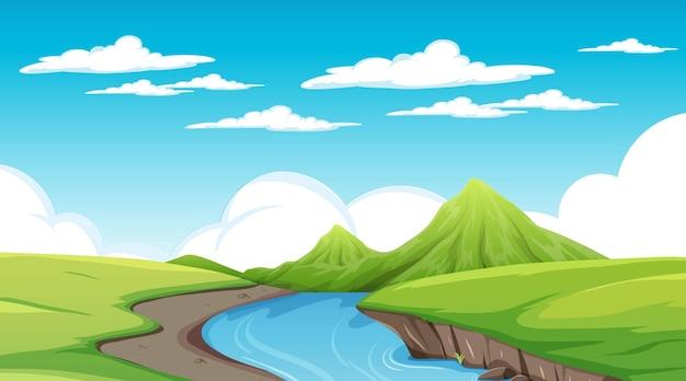 Река течет через луг пейзажной сцены
