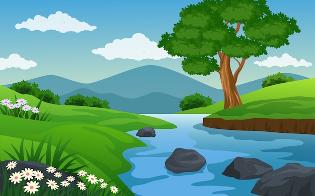 River in green field with tree and mountain