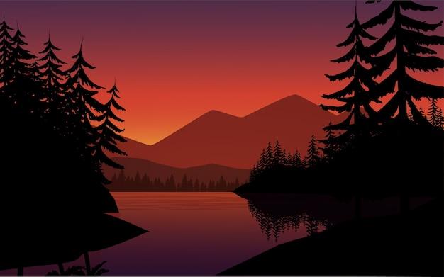 木のシルエットと川の風景