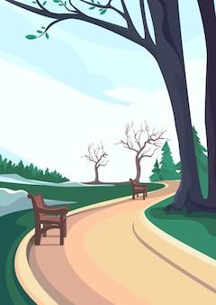 春の公園の道。垂直方向の自然景観。