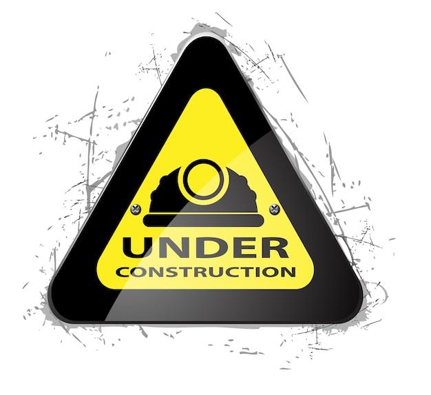 Дорожный предупреждающий знак под значком строительства