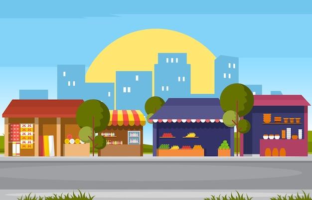 街のイラストで道端の果物野菜店の屋台の食料品店