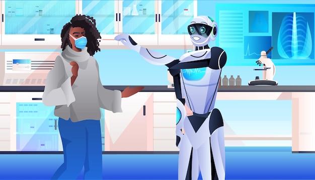 患者のpcr診断手順covid-19パンデミックからのコロナウイルスサンプルの綿棒テストを受けるロボット医師