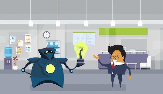 Robot giving asian business man light bulb