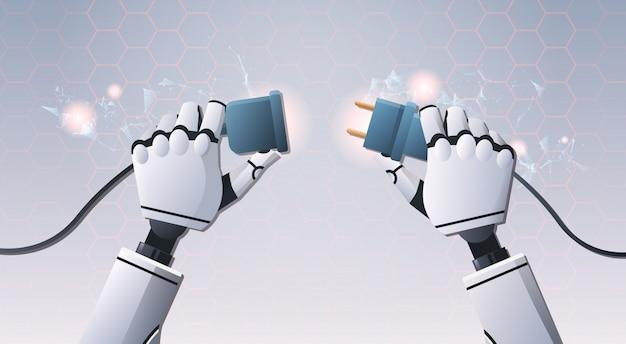 Руки робота вставляют вилку в розетку