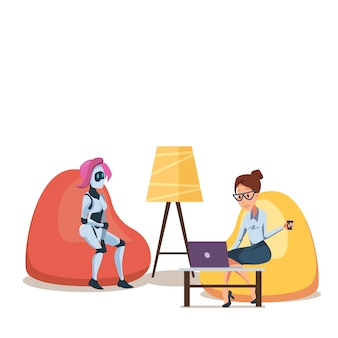 Robot and woman with laptop in bean bag chair
