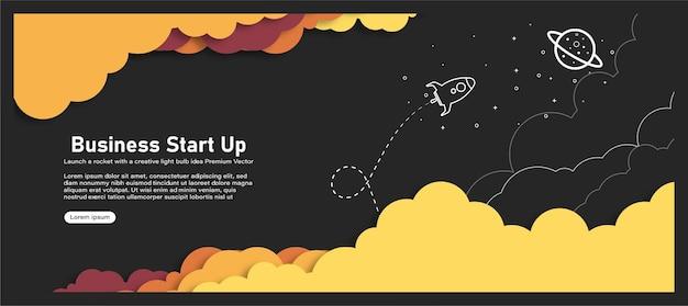 ロケットは、星で満たされた雲と青い空、ペーパーアートのある宇宙、クラフトモデルで打ち上げられました。起業プロジェクトコンセプトバナー