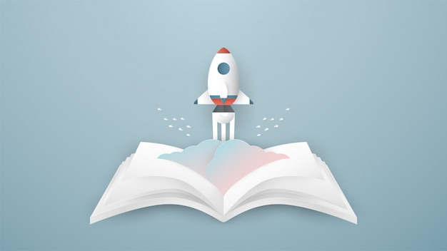 Rocket rises from the opened book.