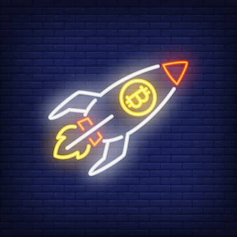 Rocket with bitcoin neon sign. launching spaceship with cryptocurrency symbol.