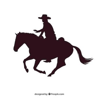 ロデオカウボーイが馬に乗って