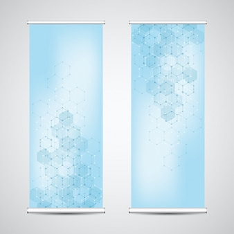 Roll up banner stands with abstract geometric background of hexagons .