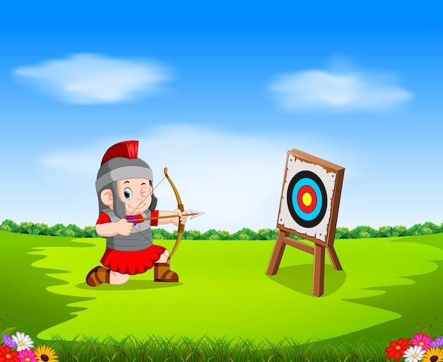 弓とターゲットを持つローマ兵士