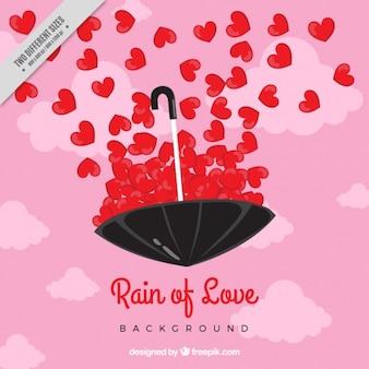 赤の心と傘とのロマンチックな背景
