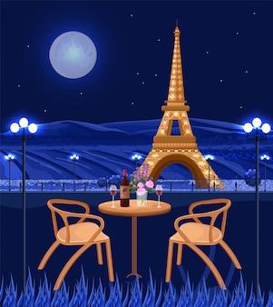 夜のエッフェル塔を持つロマンチックなカフェ