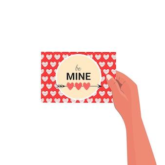 Романтическая открытка в руке со словами будь моим в современном плоском стиле