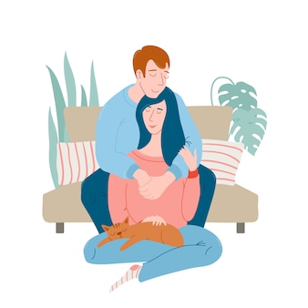 Romantic couple at home, man sitting on sofa, hugging woman with sleeping cat