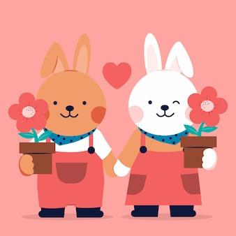 Coppia romantica di conigli amorevoli con fiori