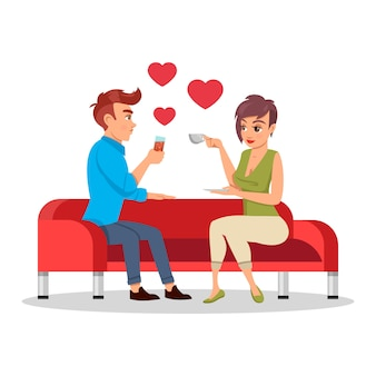 Romantic couple sitting on sofa with drinks at romantic date. valentine`s day concept.