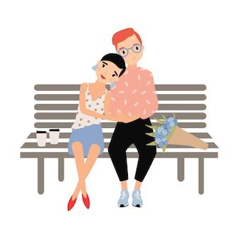 孤立したベンチに一緒に座っているロマンチックなカップル