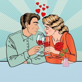 Романтическая пара с бокалами вина в ресторане. поп арт.