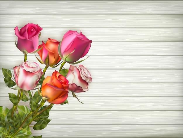 ロマンチックな花のフレームの背景。バレンタインデーの背景。木製の背景にバラ。含まれるファイル