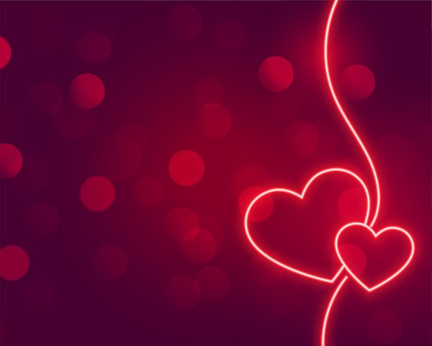 Romantic neon hearts glowing on bokeh