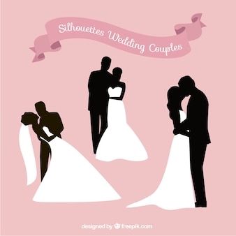 Romantic silhouettes of wedding couples