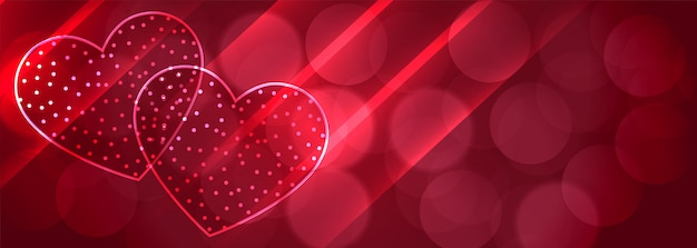 Romantic two shiny hearts bokeh banner background