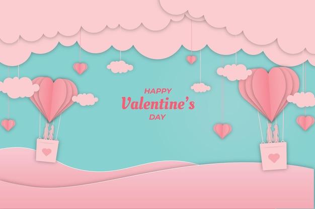 ピンクの飛行船の背景のロマンチックなバレンタインカップル