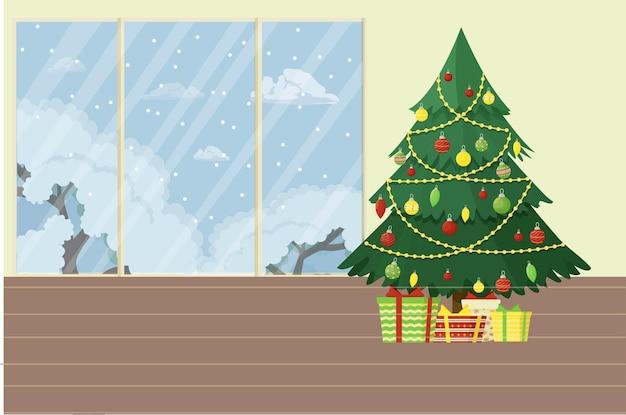 장식된 크리스마스 트리와 눈 덮인 풍경이 있는 큰 창문이 있는 실내