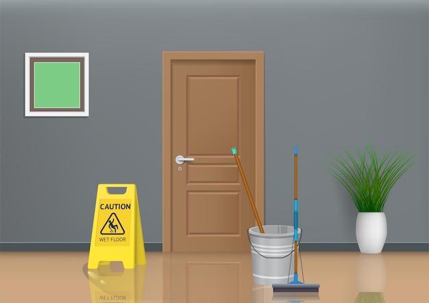 濡れた床の看板とモップと水のバケツのある部屋