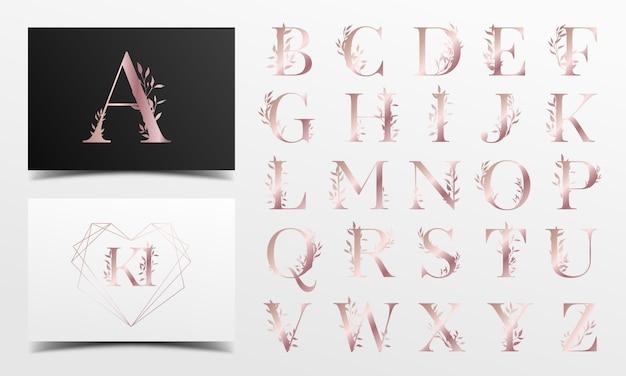 Alfabeto in oro rosa con motivi floreali