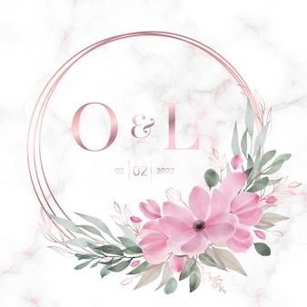 Cornice cerchio in oro rosa con fiori su marmo per logo monogramma di nozze e carta di invito