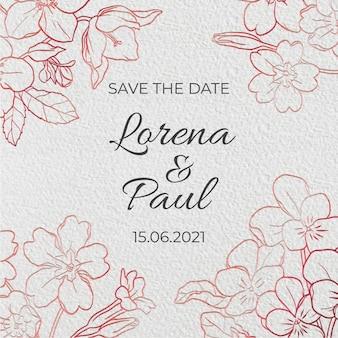 ローズゴールドの花の刻まれた結婚式の招待状