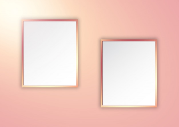 Rose gold picture frames on spotlit wall