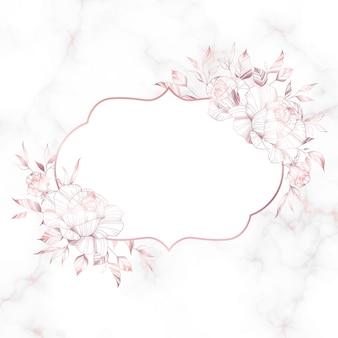 大理石の背景にバラの花とローズゴールドのヴィンテージフレーム。