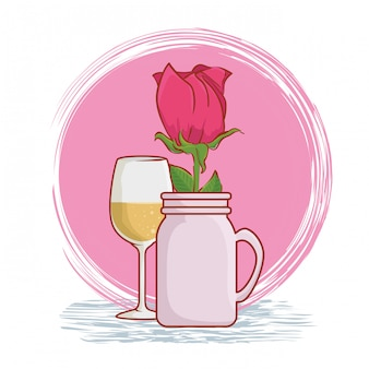 Rose plant with leaves inside vase and champagne glass