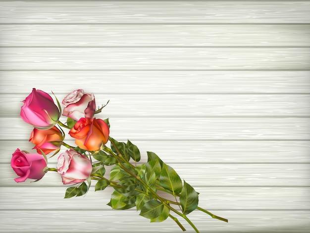 木製の背景にバラ。含まれるファイル