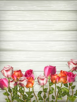 Roses on wooden background table.   file included