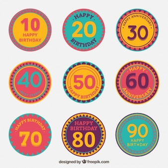 Round birthday badges with numbers Free Vector