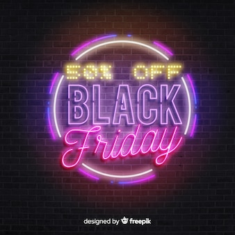 Round black friday in neon lights on brick wall