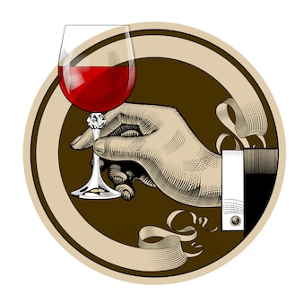 Round brown retro label with ribbon and man's hand holding a glass with red wine