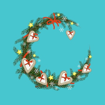 Round christmas wreath of fir branches with gingerbread, star and snowflake. festive decoration for new year and winter holidays