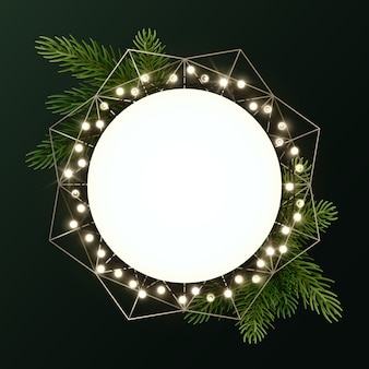 Round christmas wreath with fir branches and luminous garland of bulbs. circle with copyspace.