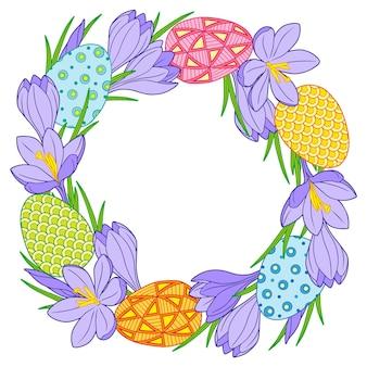 밝은 부활절 달걀과 크로커스 꽃으로 만든 둥근 프레임