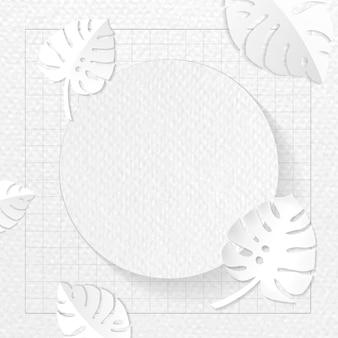 灰色のモンステラ模様の背景に丸いフレーム
